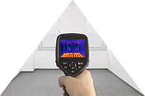 Hand-held thermal imaging camera used during a home inspection.